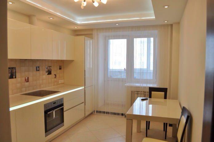 многоуровневый белый натяжной потолок на кухне