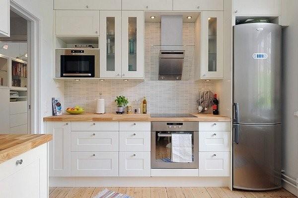 холодильник в интерьере кухни в скандинавском стиле